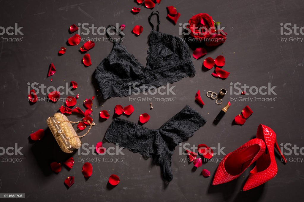 39a48ddaaea Women's black lace sexy lingerie and accessories on black surface royalty-free  stock photo