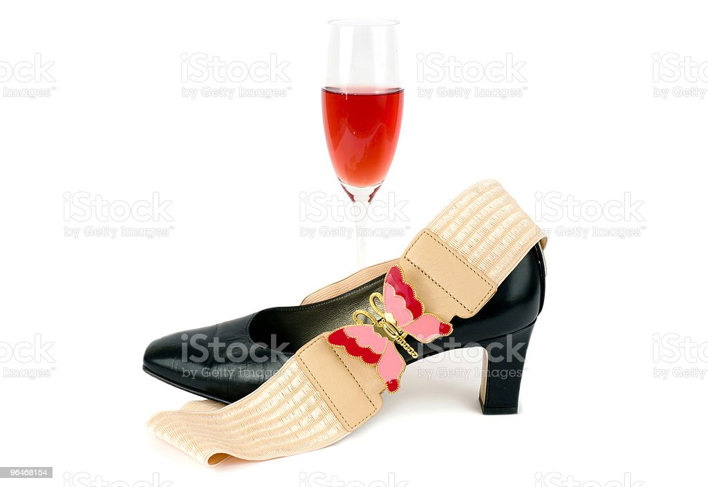 Women's black shoes , red drink and belt royalty-free stock photo