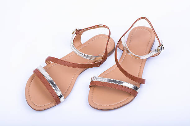 women's brown sandals on white background. top view - flat shoe stock pictures, royalty-free photos & images
