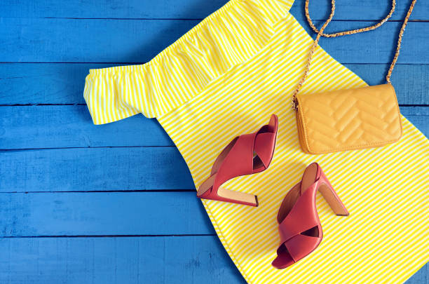 womens clothing, accessories, footwear (yellow dress,  leather terracotta heel shoes,  crossbody bag). fashion outfit. shopping concept. flat lay. trendy, saturated colors. spring summer collection - spring fashion stock pictures, royalty-free photos & images