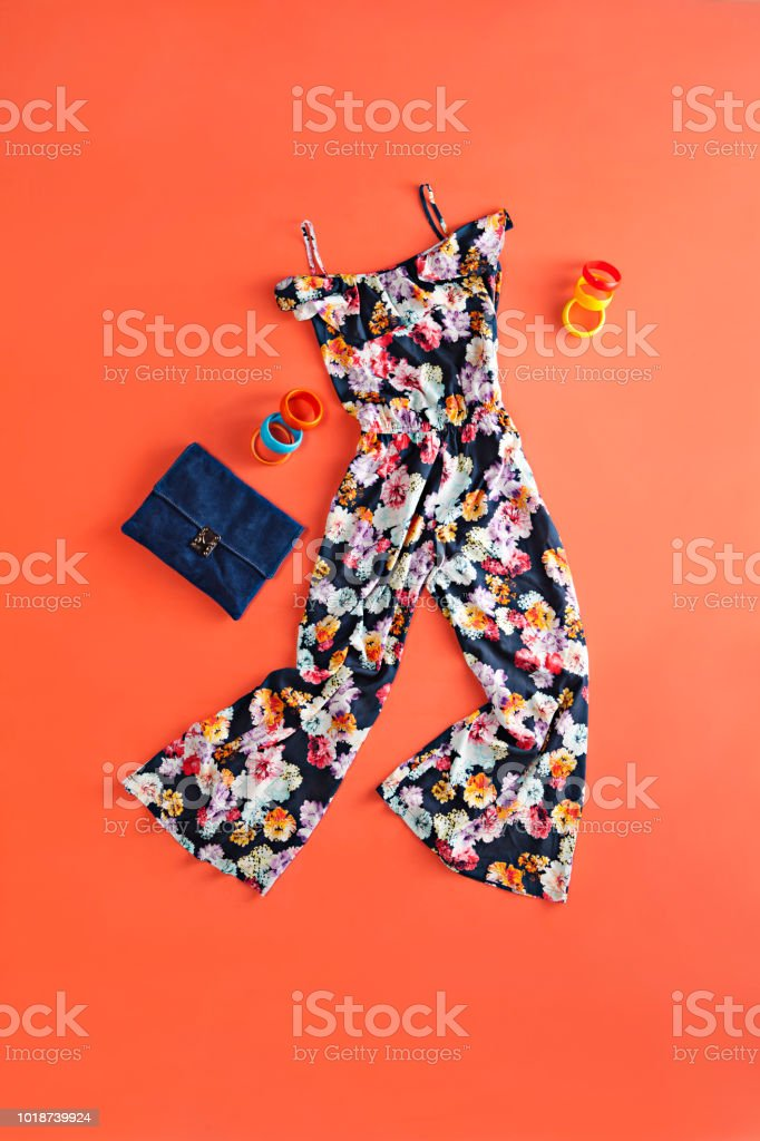 Women's clothing and personal accessories on orange background