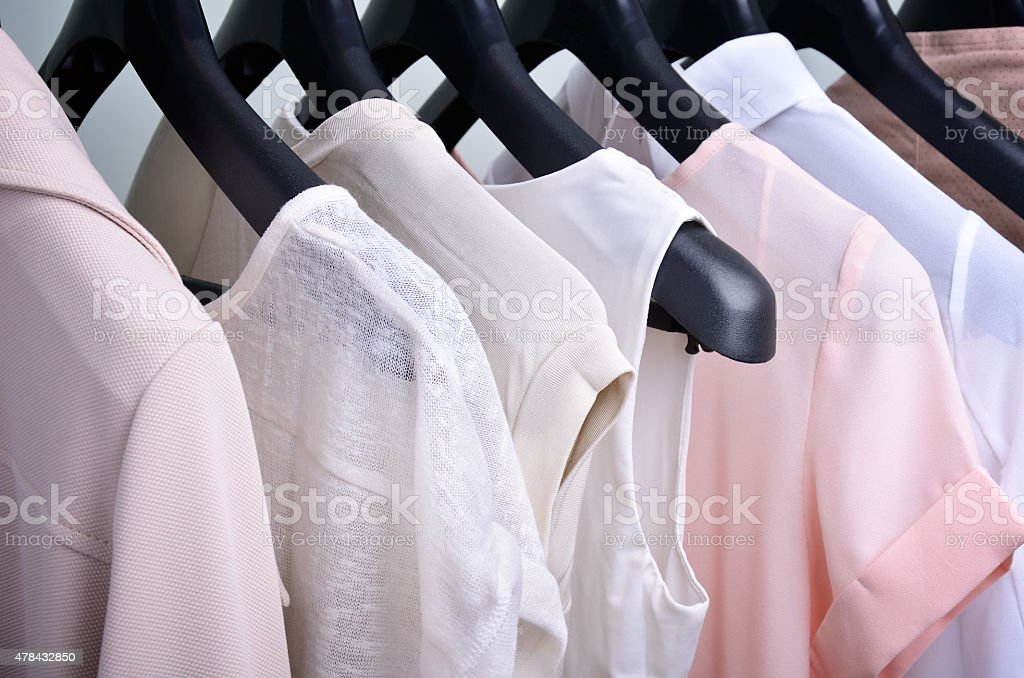 womens clothing pastel colors hanging on the hanger stock photo