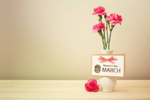womens day march 8th card with carnations - womens day stock photos and pictures