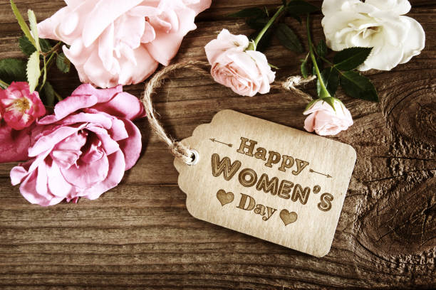 womens day message with rustic pink roses - womens day stock photos and pictures