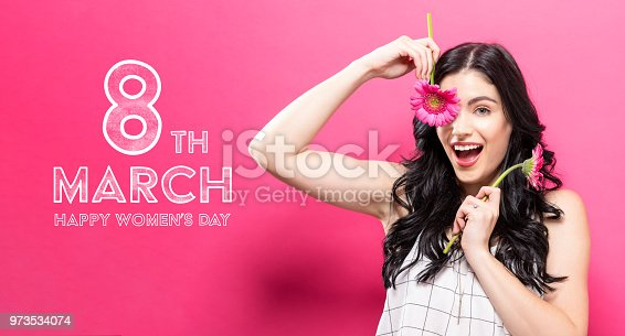 istock Womens Day message with young woman with garbela 973534074