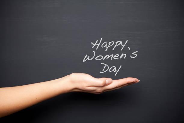 Women's Day Note on chalk board stock photo