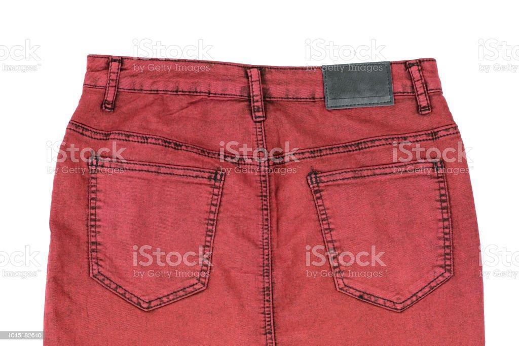 0546cf6e8 Púrpura de mujer denim falda aislado sobre fondo blanco. Vista trasera.  Denim moda Ropa