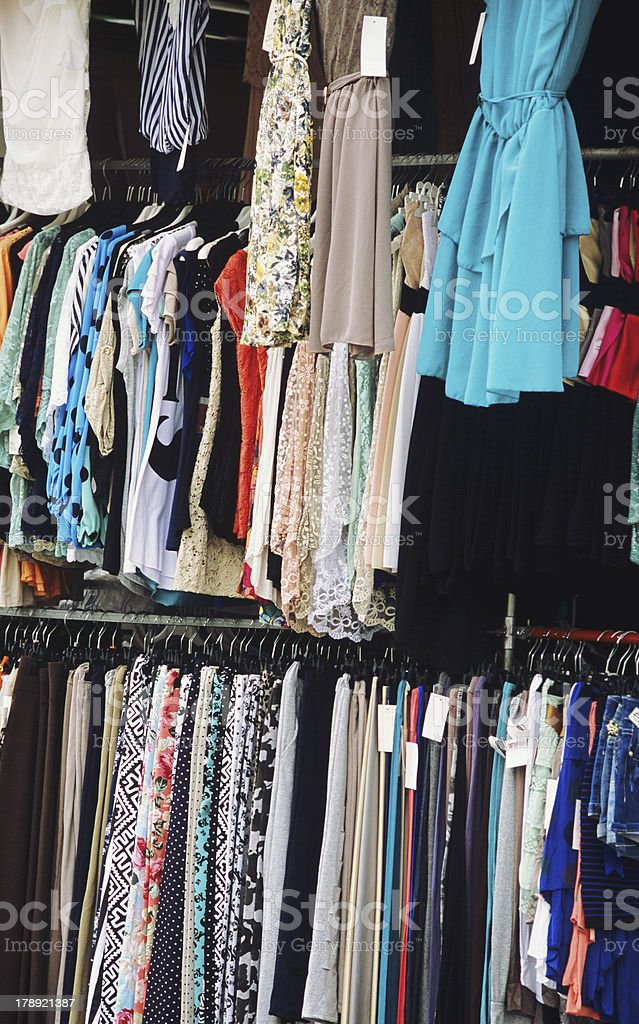 Women's dresses and clothes at the flea market royalty-free stock photo