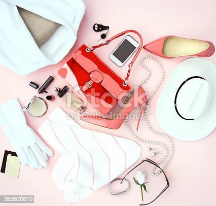 istock Women's fashion accessory white clothing and red high heels is located on a light  pink background. Top view. 953820610