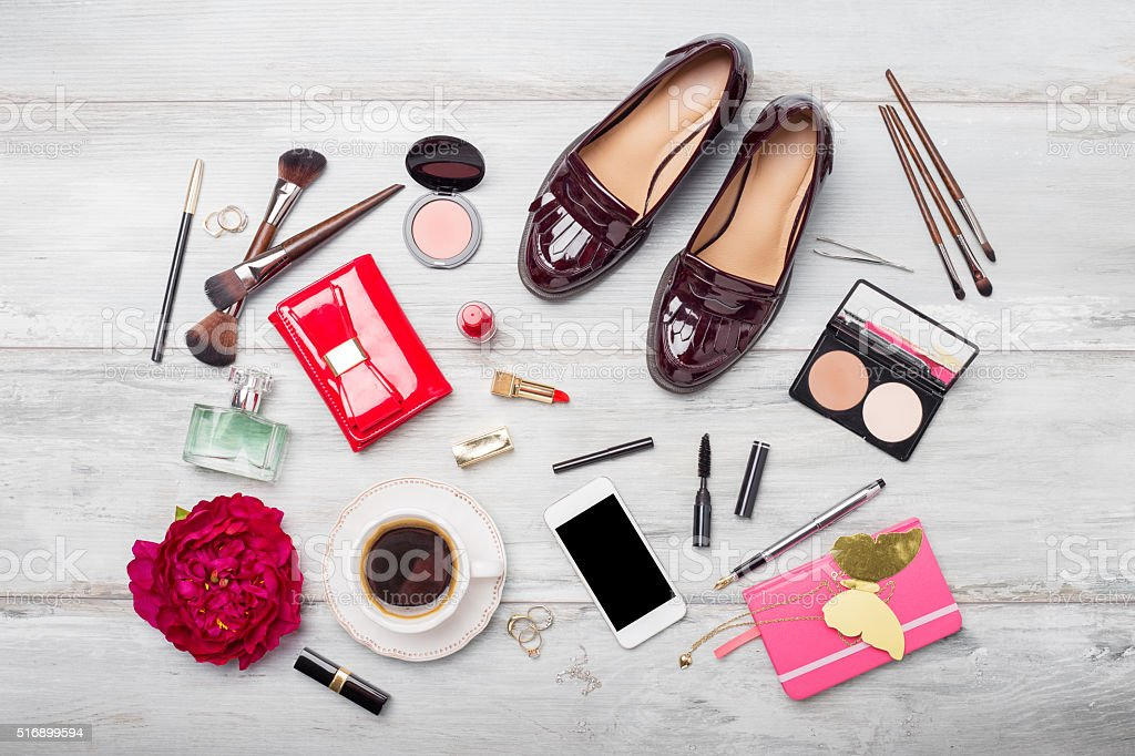 Women's fashion and beauty objects and accessories on wooden floor stock photo