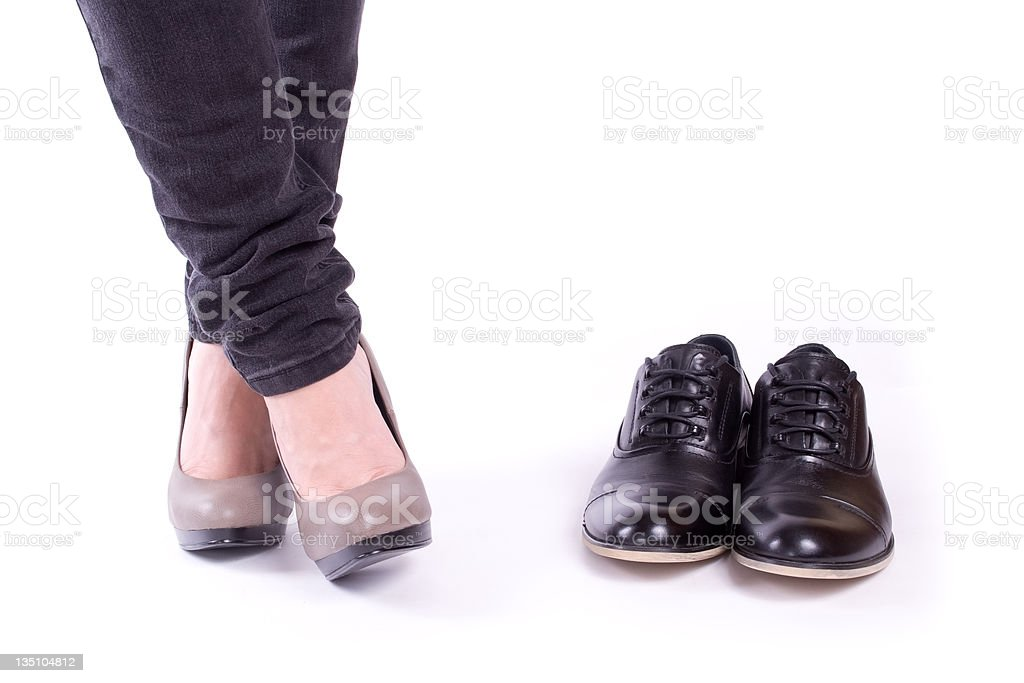 Women's feet and men's shoes royalty-free stock photo