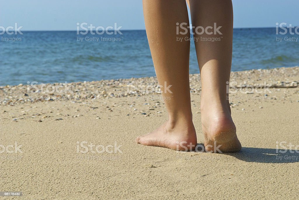 women's feets against the background of sea royalty-free stock photo