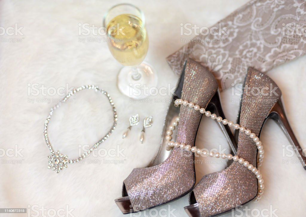 high heels with pearls on them