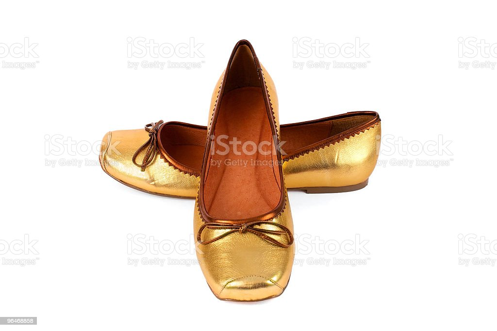 Women's gold leather shoes royalty-free stock photo