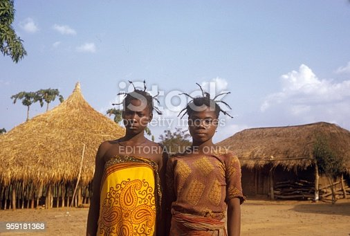 Congo, Central Africa, 1974. Two young African women with special tribal hair style.