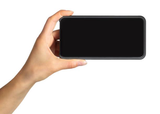 frauenhand mit schwarzem smartphone, konzept des fotografieren oder selfie - fotohandy stock-fotos und bilder
