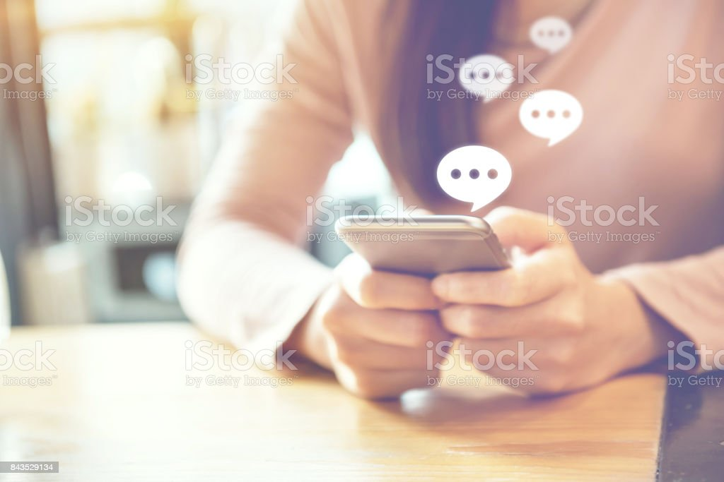 women's hand typing on mobile smartphone, Live Chat Chatting on application. stock photo