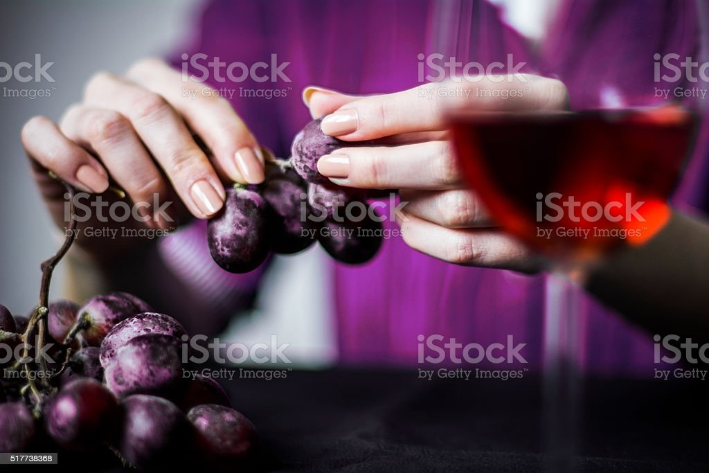 Women's hand with grapes stock photo
