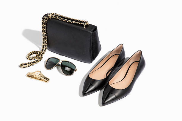 women's handbag, flat shoes with personal accessories - flat shoe stock photos and pictures