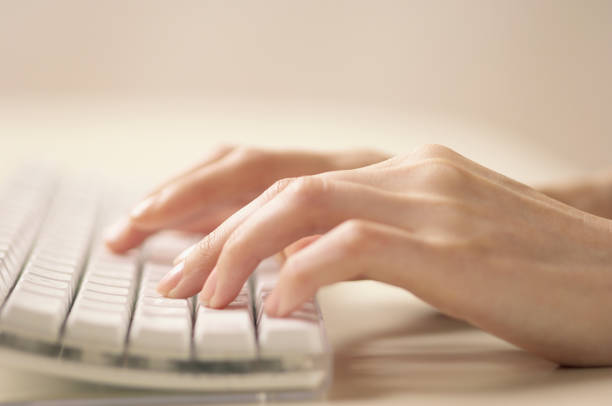 Women's hands and keyboard stock photo