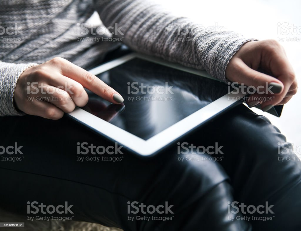 Women's hands holding the tablet. Beautiful manicure. Modern technology, entertainment, recreation, education royalty-free stock photo
