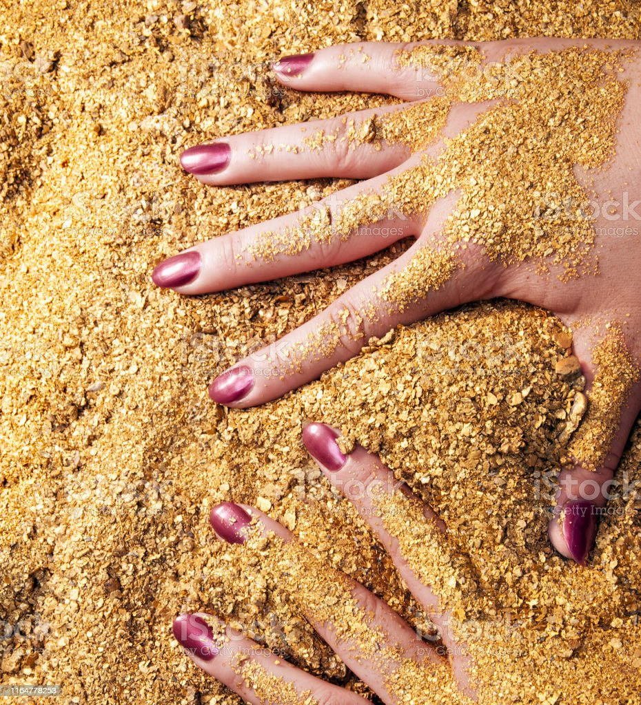 Women\'s hands, manicure, natural natural gold AU, of the highest...
