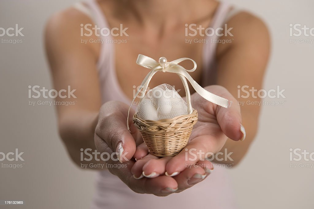 Here, pays you a gift. Woman holding gift box.