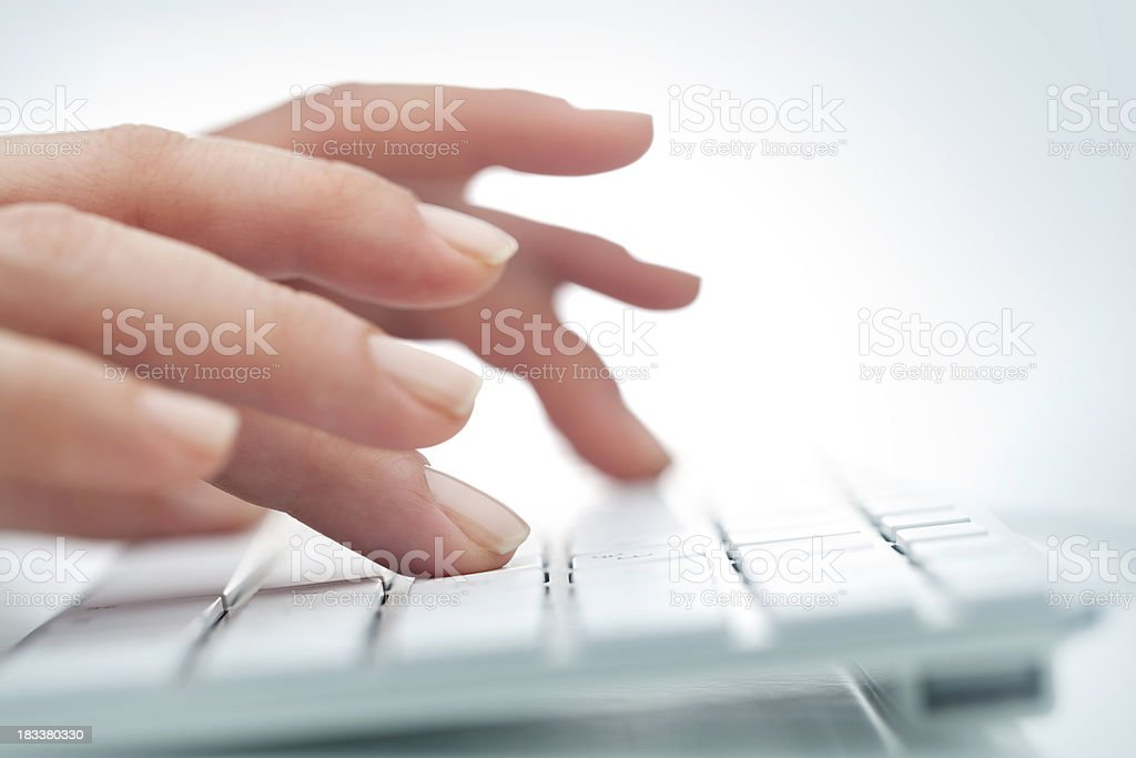 Women's hands on white computer keyboard royalty-free stock photo