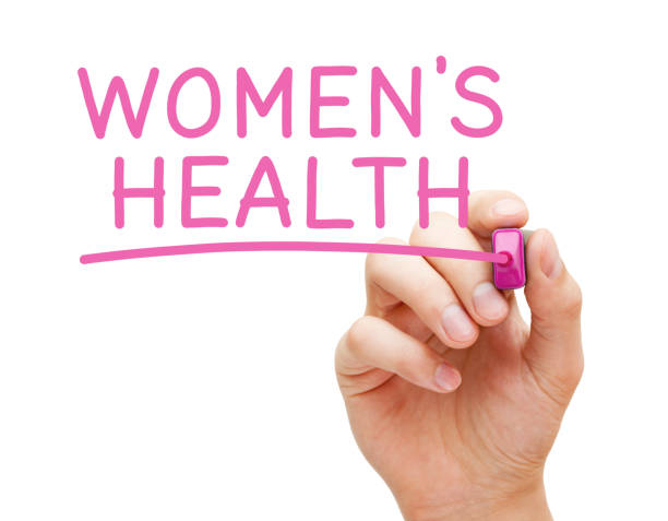 Womens Health Handwritten With Pink Marker Hand writing Women's Health with pink marker on transparent wipe board isolated on white background. women's issues stock pictures, royalty-free photos & images