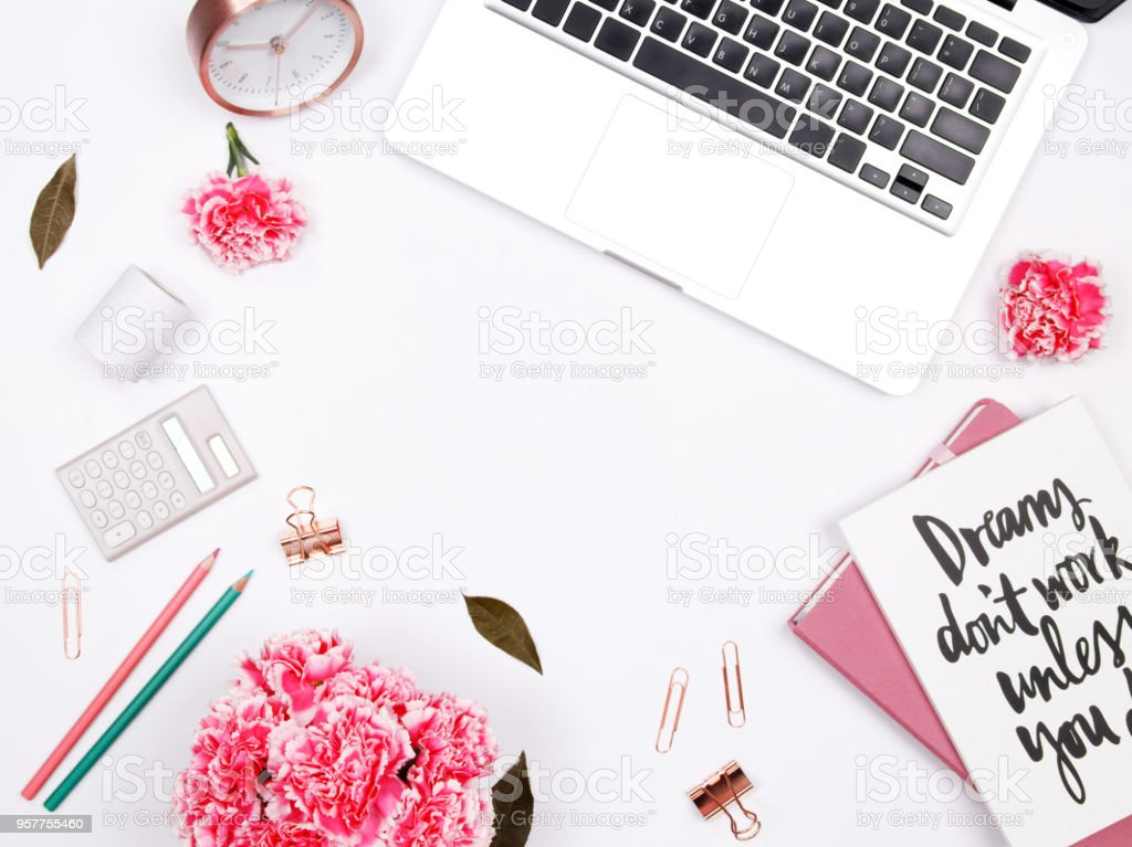 Women's home office desk workspace.