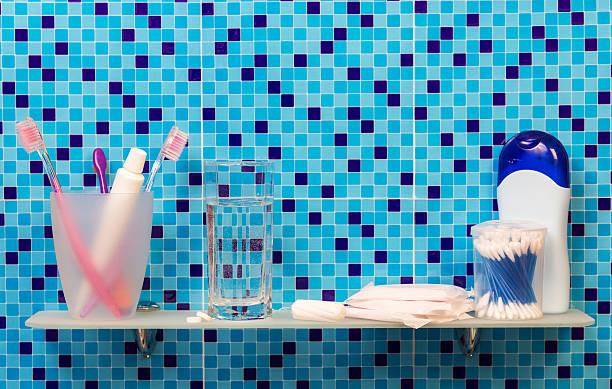 women's hygiene products on shelf in bathroom. background. - bindewörter stock-fotos und bilder