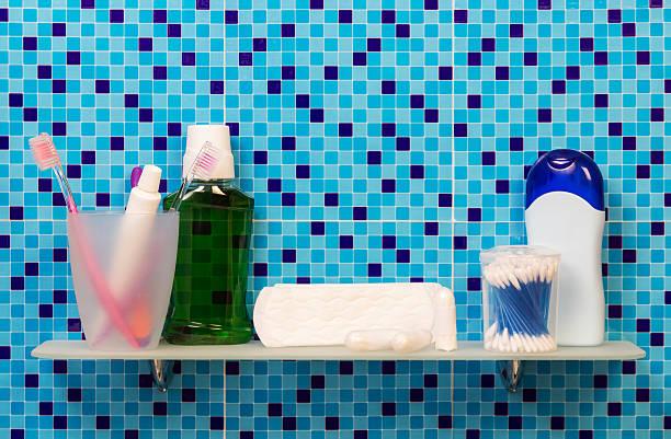 women's hygiene products on shelf in bathroom, background. - bindewörter stock-fotos und bilder
