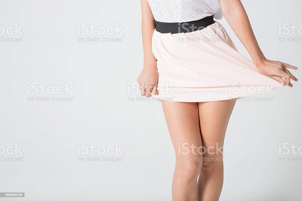 Women's legs in a skirt stock photo