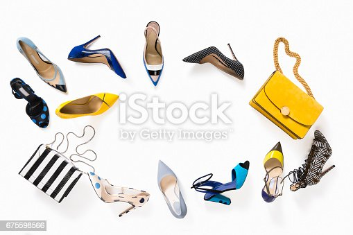istock Women's luxury high heels with handbag isolated on white background 675598566