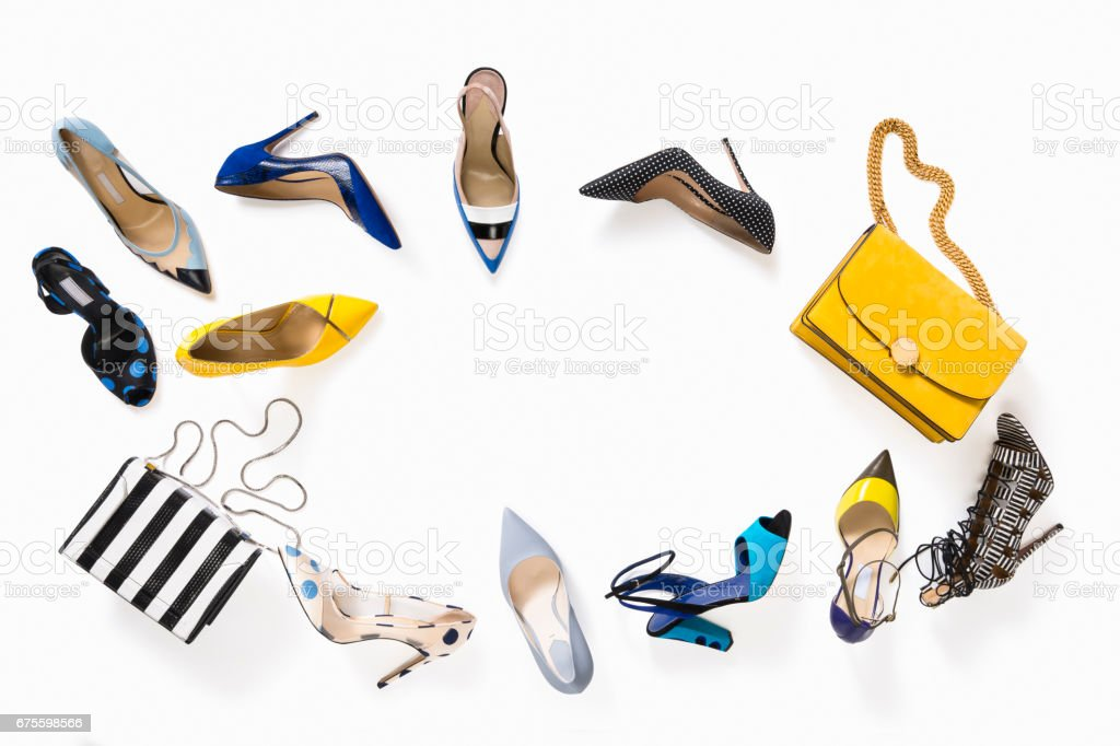 Women's luxury high heels with handbag isolated on white background stock photo