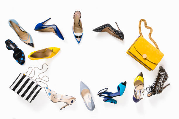 women's luxury high heels with handbag isolated on white background - shoes fashion stock photos and pictures