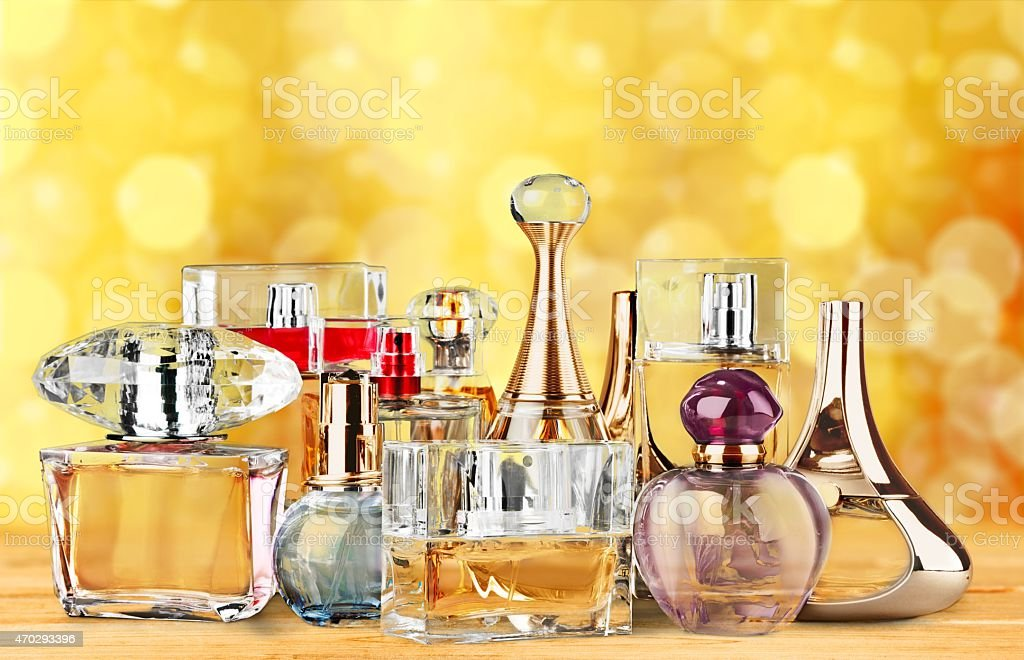Women's perfume bottle displayed against bokeh background stock photo