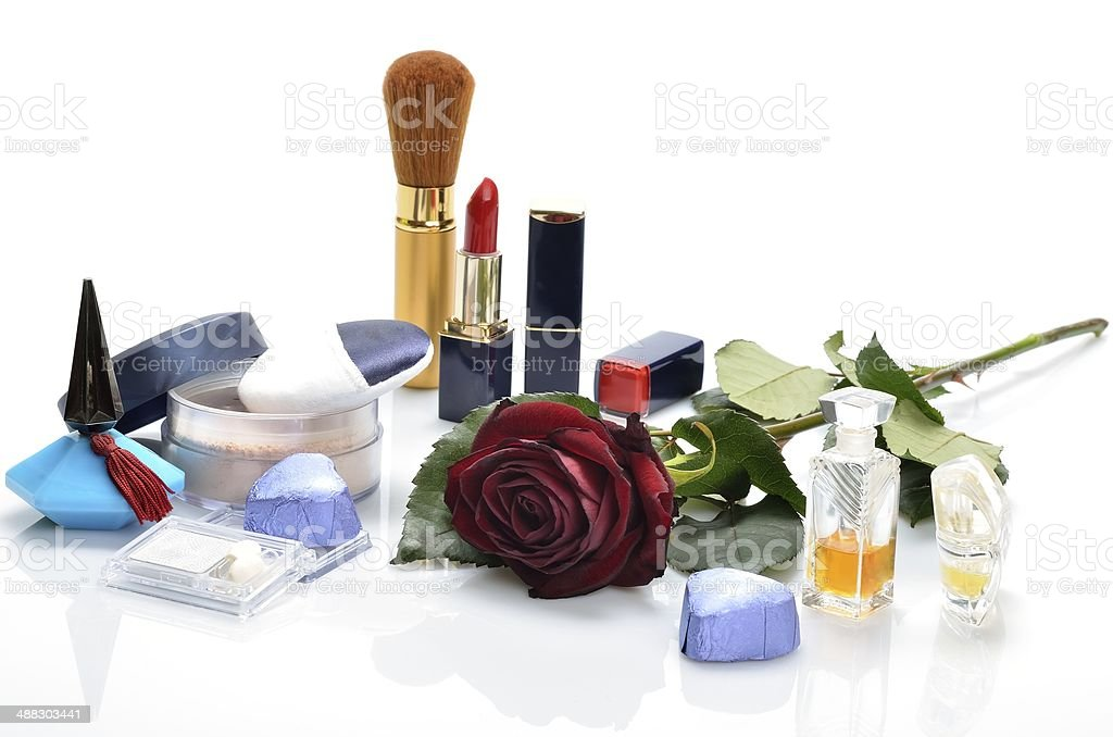 Women's perfumes, cosmetics and a flower in still life royalty-free stock photo