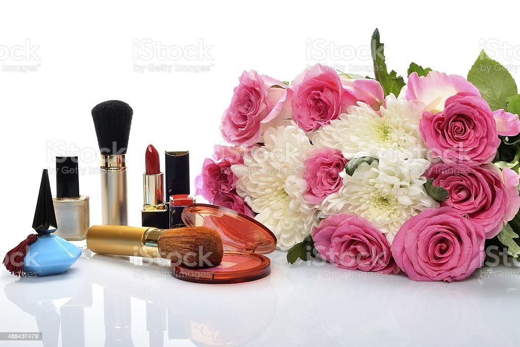 Women's perfumes, cosmetics and  bouquet flowers in still life royalty-free stock photo