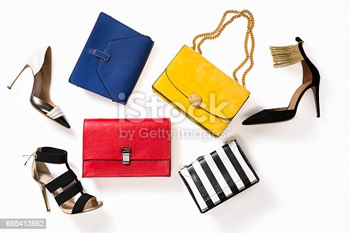 Leather high-heels shoes and colorful handbags isolated on white background ( with clipping path)