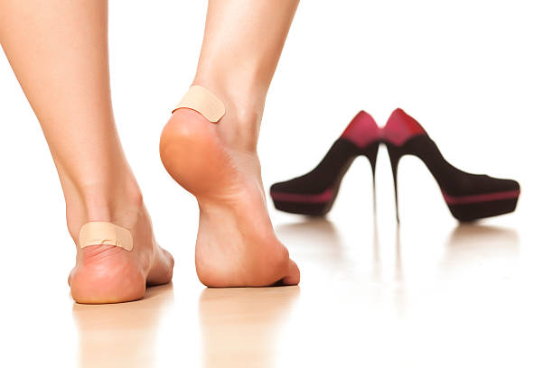 women's problems use of sticky plasters due to tight footwear blister stock pictures, royalty-free photos & images