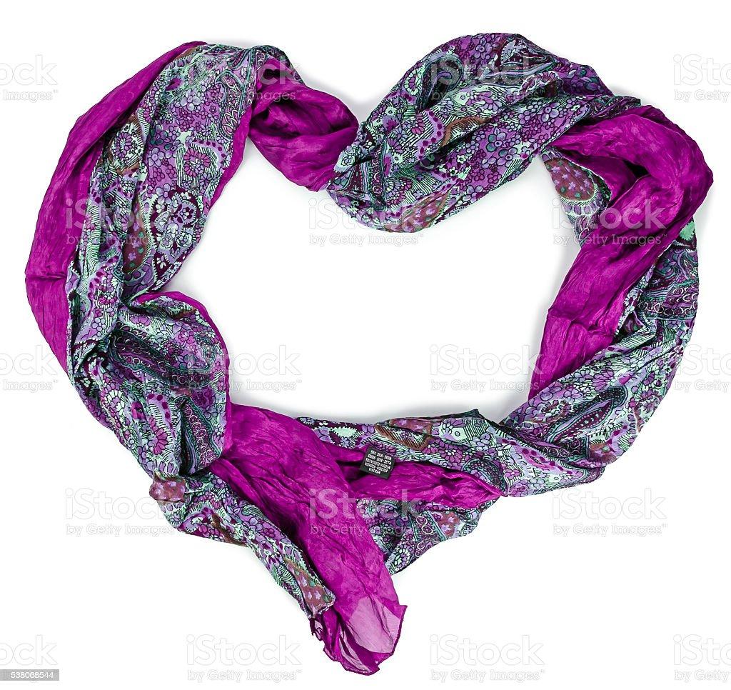 Women's purple silk scarf in form of heart stock photo
