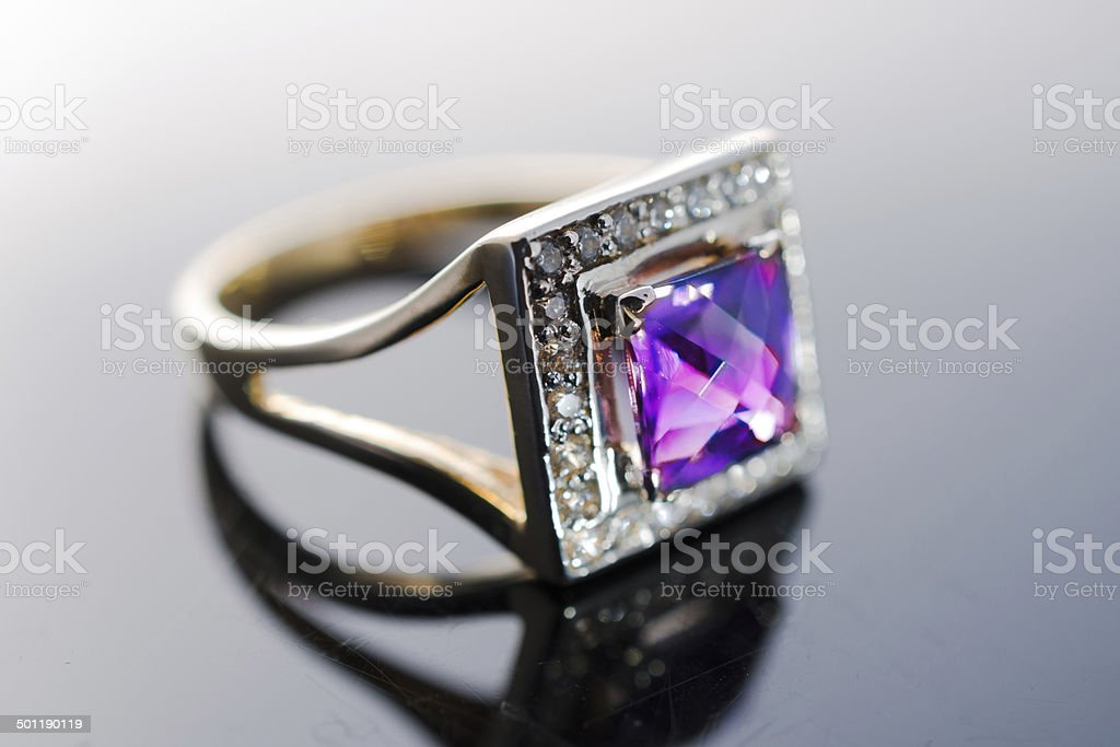 Women's ring with purple ruby and amethyst stones royalty-free stock photo