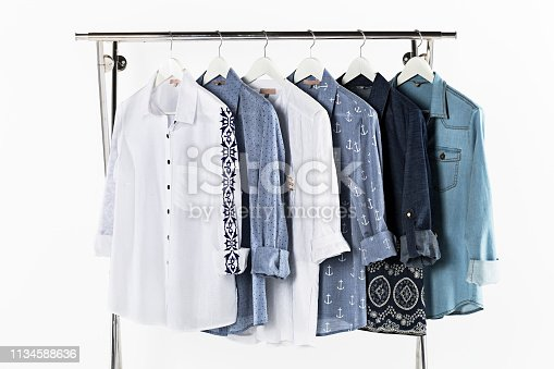 Women's shirts on coat hangers isolated on white background (with clipping path)