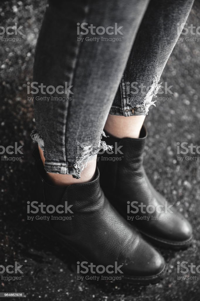 women's shoes and jeans on the beach in the sand royalty-free stock photo