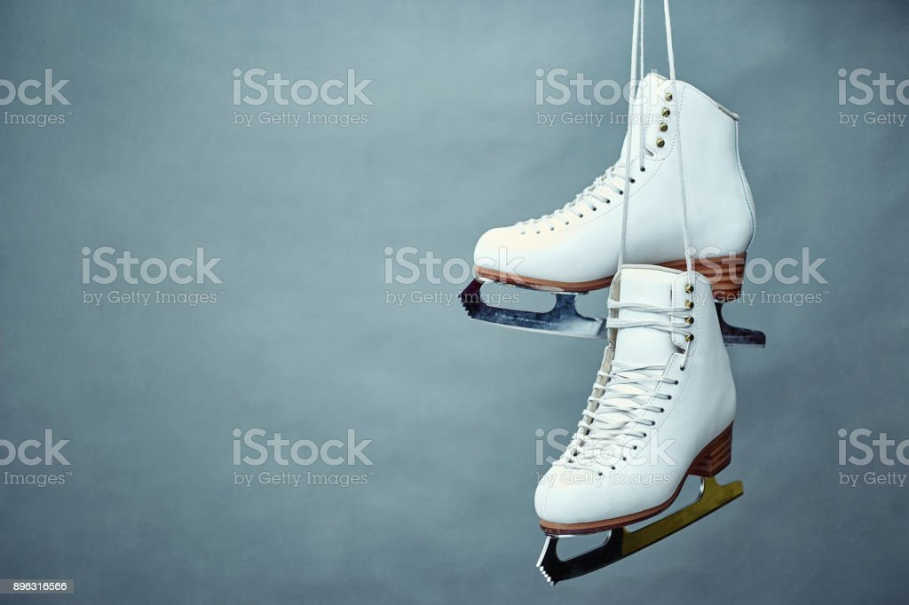 Women's skates with laces on a gray background. stock photo