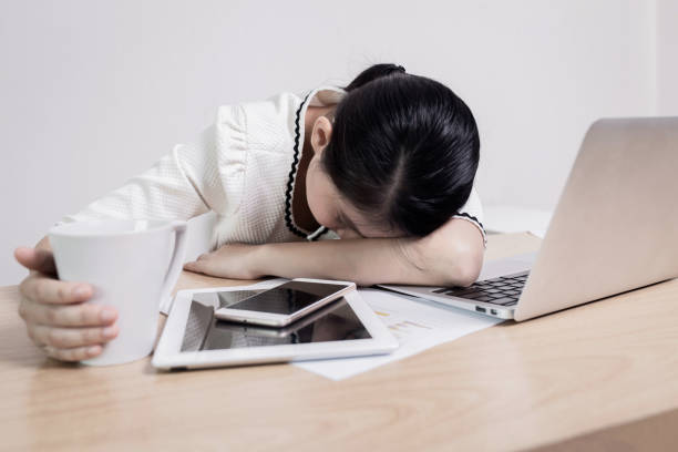 Women's sleep and tired from work on table work in quarantine for coronavirus 2019 disease. Work from home concepts. Women's sleep and tired from work on table work in quarantine for coronavirus 2019 disease. Work from home concepts. zoom effect stock pictures, royalty-free photos & images