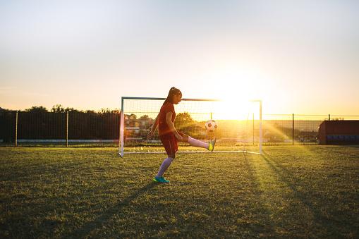 Women's soccer player on training.