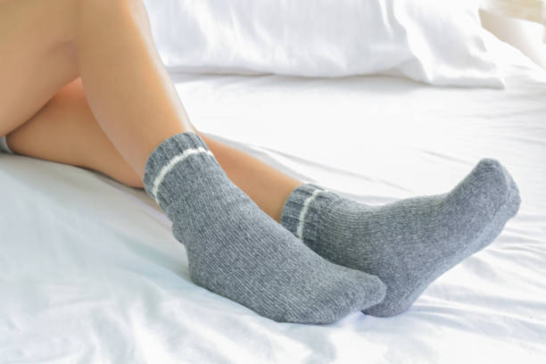 Women's socks on bed stock photo