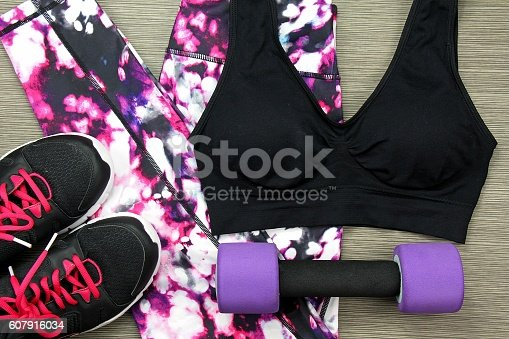 istock Women's sport wear and Dumbbell. Fitness wear and equipment. 607916034